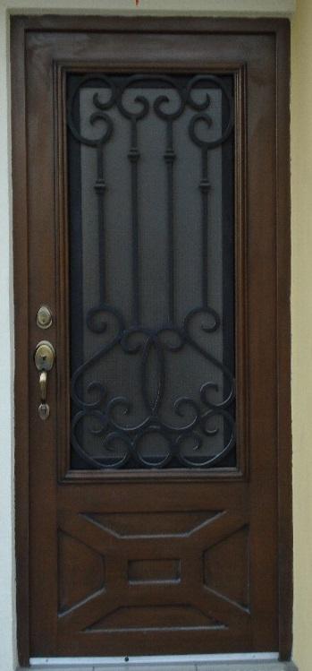 Herreria carmona puertas de forja for Fotos de puertas principales